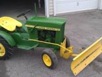 this is a 1964 john deere 110 little tractor that is