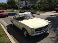 1964 Mercedes 230SL  with brand new tan interior. 4