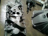 I have a factory cast iron 2 barrel intake manifold off