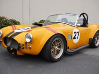 This 1965 AC 427 Cobra 2 Door Roadster. built in 2000.