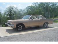 This is a nice solid and straight 65 Biscayne 2 dr.,