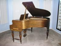For sale is a baby grand piano made by The Everett