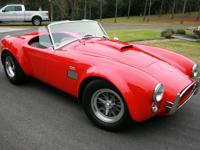1965 Ford Cobra by Superformance Monza red. This