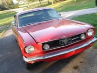 1965 fastback mustang, has the 289 with added four