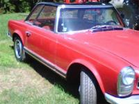 1965 Mercedes Benz 230SL. Red with black interior. Two
