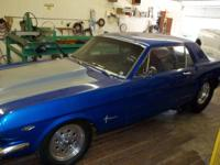 1965 Mustang. Color: Blue with an air induction hood,
