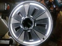 I have two original chrome 1965 mustang hubcaps.  The
