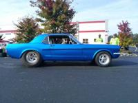 Beautiful 65 mustang coupe painted speedway blue with