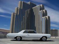 This 1965 Oldsmobile 442 2dr 2 Door Coupe features a