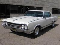 1965 OLDSMOBILE 442- WHITE WITH BLUE INTERIOR AND IN