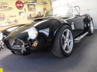 Early Factory five Replica. Has all the cobra markings