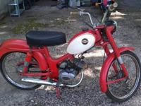 It is a 50cc grip shift 3 speed Harley built in Italy.
