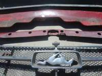 the 1965 mustang in a corral emblem, upper valance,