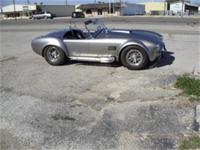 1965 Shelby Cobra 428 five speed. Signed by shelby.