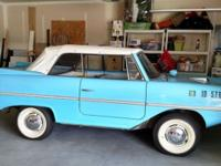 Lagoon blue 1966 Amphicar 770 convertible. You can