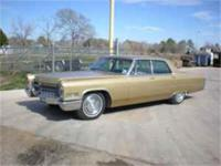 1966 Cadillac Deville, gold exterior with beige