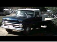 This 1966 Chevrolet C 30 one ton flatbed truck has a