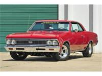 A bright red, big block 66 Chevelle SS with a 4-speed