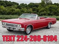 This 1966 Chevrolet Impala Convertible has a 327 C.I.