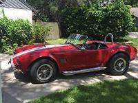 1966 Cobra Replica (FL) - $43,995 2,800 miles. Red w/