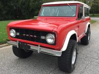 1966 Ford Bronco 44 in cherry (both the color and the