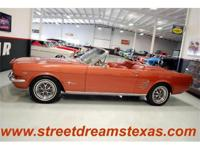 Here is a beautiful fully restored Mustang drop top. It
