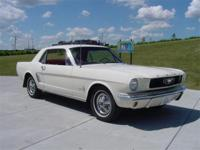 1966 Ford Mustang Coupe. Totally restored to original.