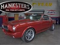 Stock # 66MUS6641. Red 1966 Mustang Fastback G.T. 350