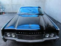1966 Lincoln Continental Convertible, triple black car,