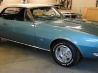 This is a very clean turquoise 1967 Camaro SS with