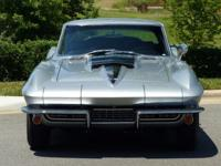 This beautiful Silver Pearl 1967 Corvette was proudly