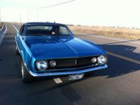1967 Chevy Camaro 327 blue with black vinyl top. I have