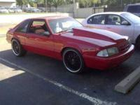 Beautiful and Seductive Red Ford Mustang in Resplendent