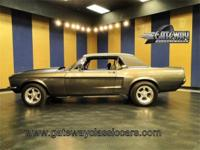 1967 Ford Mustang for sale. This charcoal with black