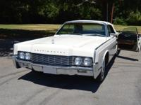 Beautiful Lincoln 67 Continental white on black with