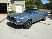We own a 1967 Brittany Blue Mustang convertible, 289
