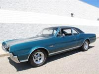 A 1967 Oldsmobile 442, 2 door post coupe with Tahoe