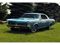 This is a Beautiful 1967 Pontiac GTO nicely painted
