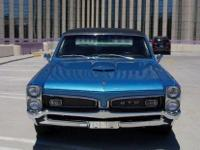 his 1967 Pontiac GTO Coupe features a 400c. i. V-8 cyl