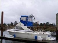 This Twin Gas recreational fishing boat is LOADED with