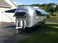 HAS A POLARIS ROTARY AIR CODITIONER. HAS A NEW TRAILER