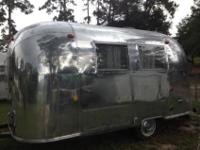 The camper is a 1968 Airstream 17 foot Caravel with