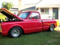RED 68 CHEVY C10 SHORT BED. HAS A 350 ENGINE WITH ONLY