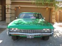 1968 Chevy Impala, custom pearl green paint job and