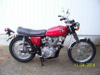 1968 Honda CL450K1 in OEM Candytone Red livery. This is