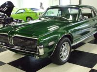 This is a Beautiful 1968 Mercury Cougar. The Green