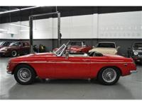 This 1968 MG B Roadster 2dr Roadster features a 4 cyl