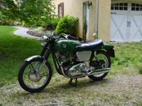 1968 Norton Commando Fastback 20M3 Green. The bike has