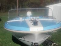 1968 performer boat with a 1963 55HP Homilite 4 stroke.