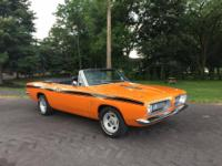 1968 Barracuda convertible. Car is now Omaha Orange